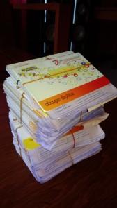 カカオ買付時に生産者が託す貯金通帳、多い時は60名分くらいになります。